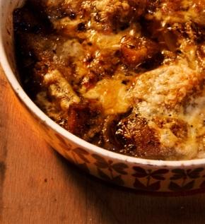 French Onion Soup in a small baked in a small casserole dish.